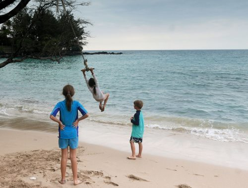 kids swinging on the beach in Hawaii family gap year
