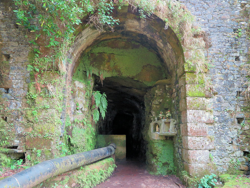 dark tunnel entrance in a stone wall, Madeira hiking trails