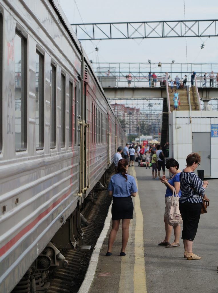 a trans siberian train at a station