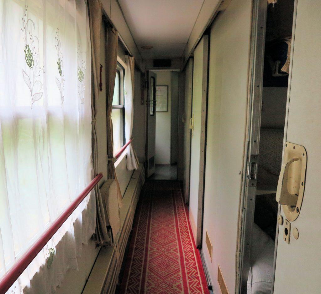 a train carriage corridor on a Trans Siberian train
