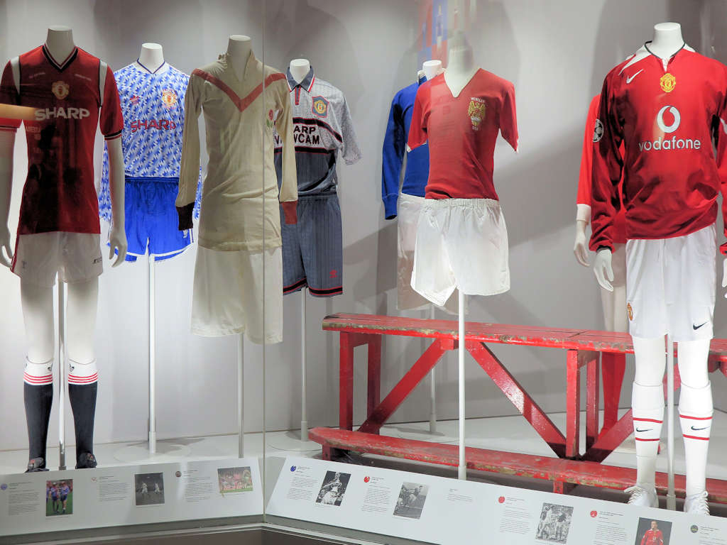 display of old football shirts at Manchester United museum