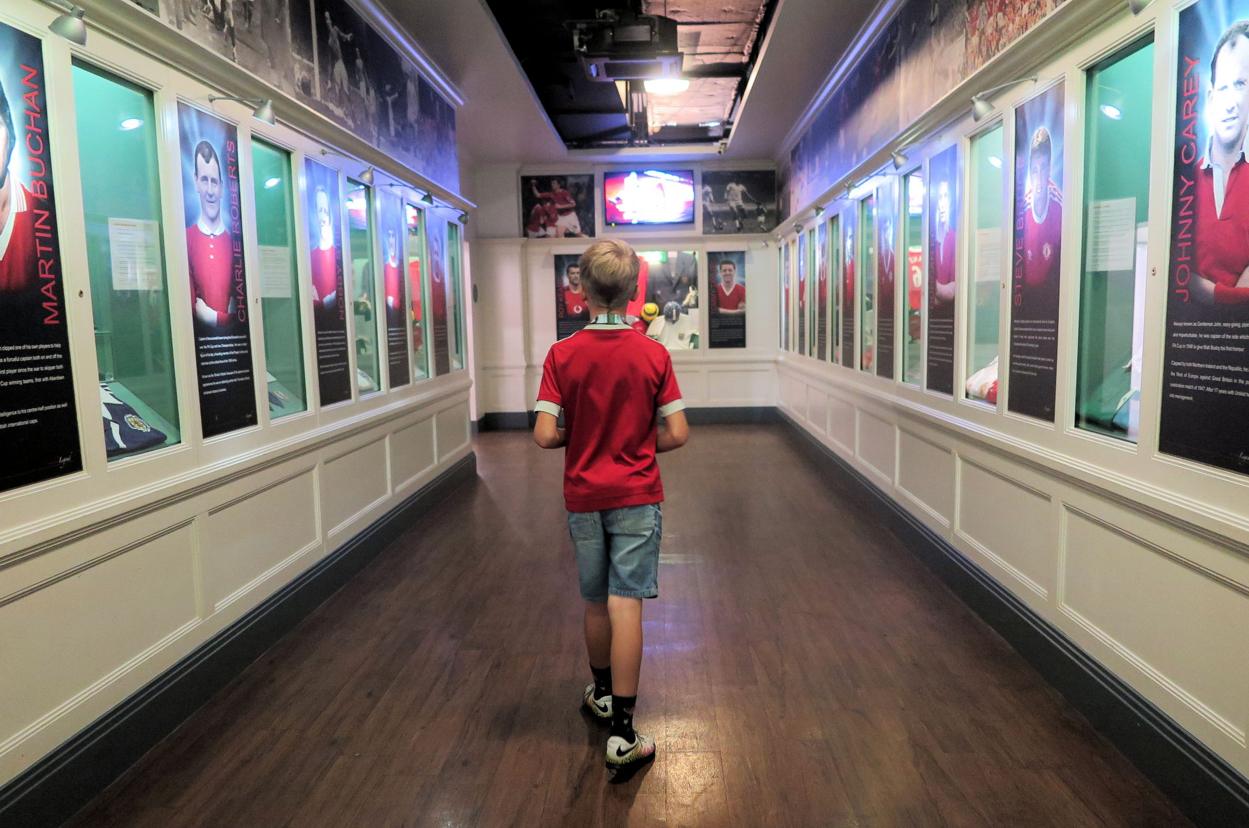 boy walking through the Manchester United museum on the Manchester United Tour