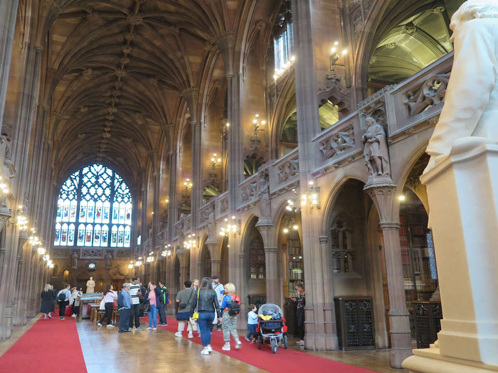 carved ceiling and stone arches at a museum library free things to do in Manchester