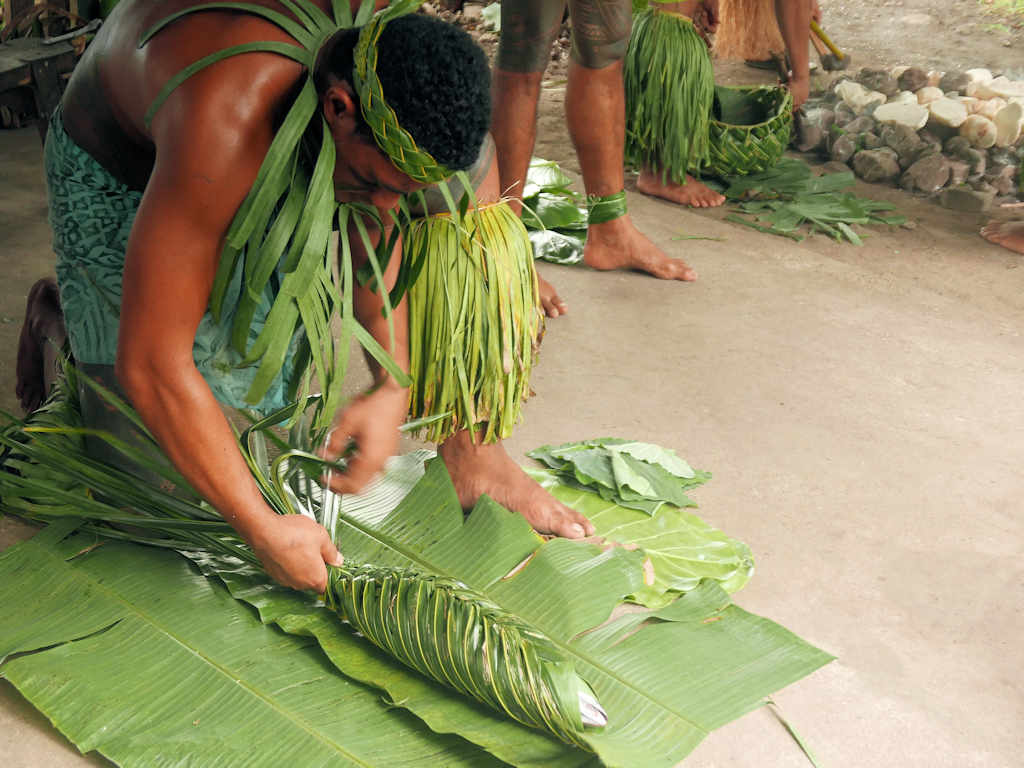 wrapping fish in leaves for cooking things to do in apia samoa