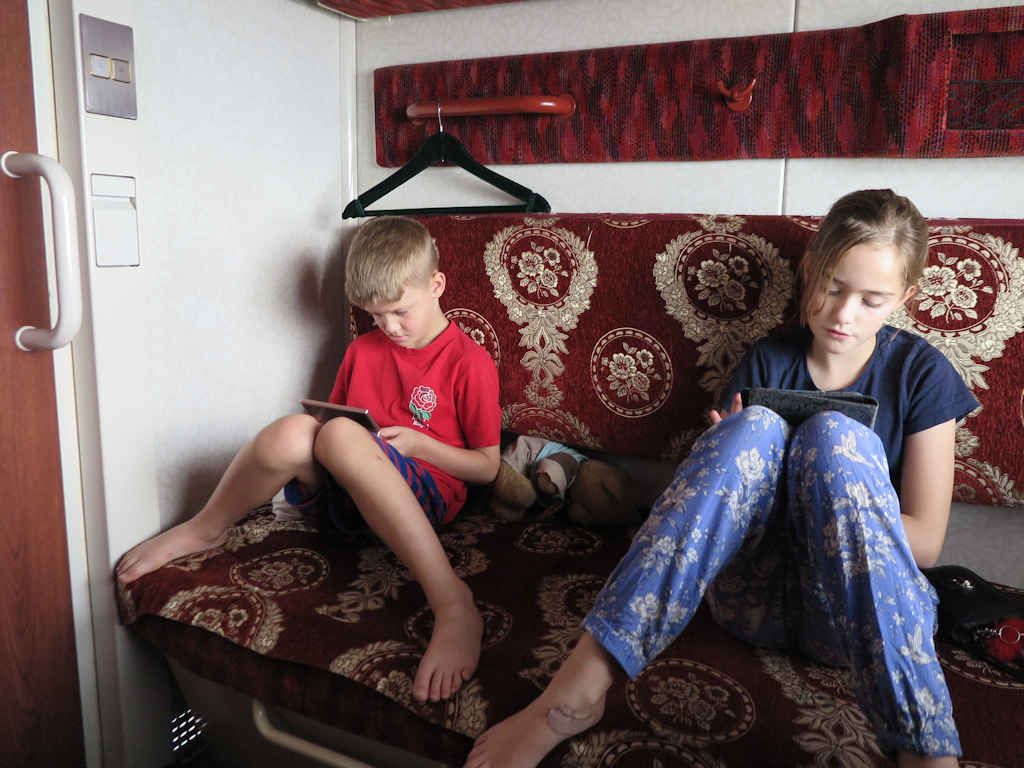 children reading on the Trans Mongolian railway