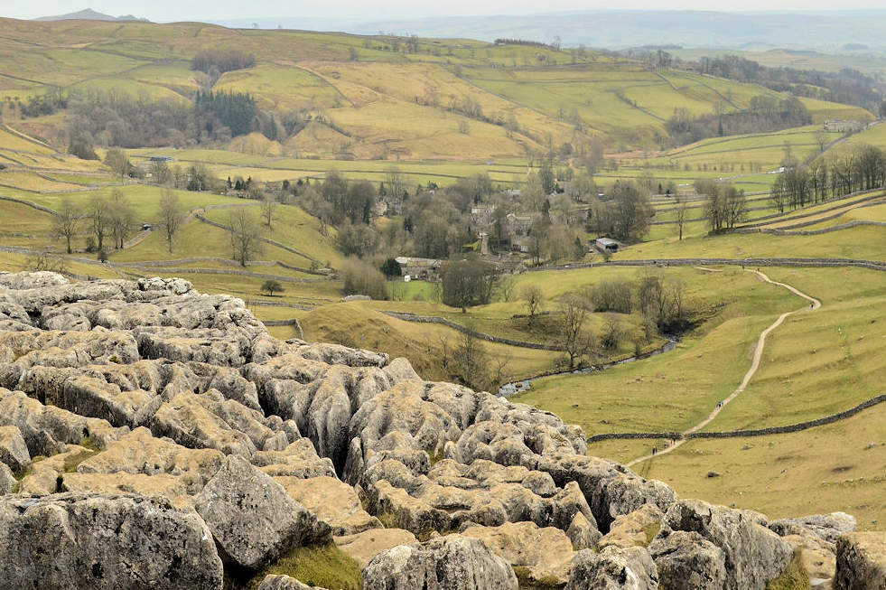 the rocky pavement and view from malham cove yorkshire dales