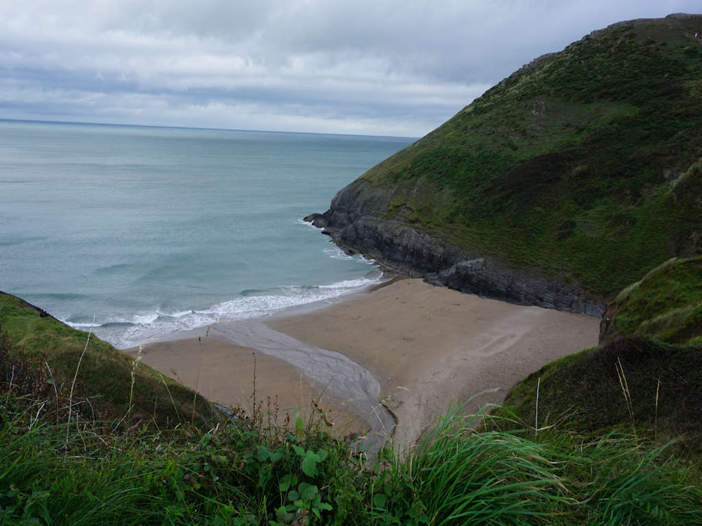 sandy cove surrounded by green hills Mwnt Beach Cardigan