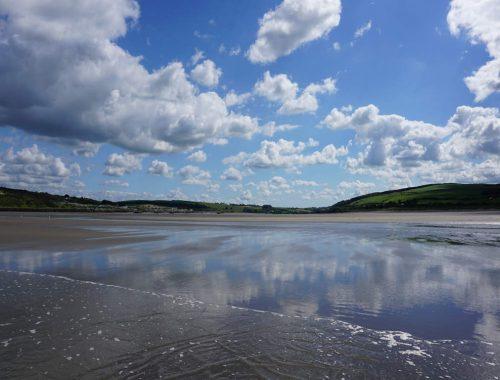 a sandy beach on a sunny day at Poppit Sands Cardigan