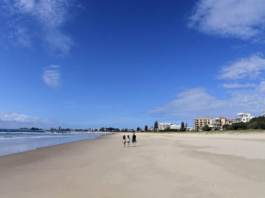 sandy beach blue sea and blue sky East Coast Australia road trip