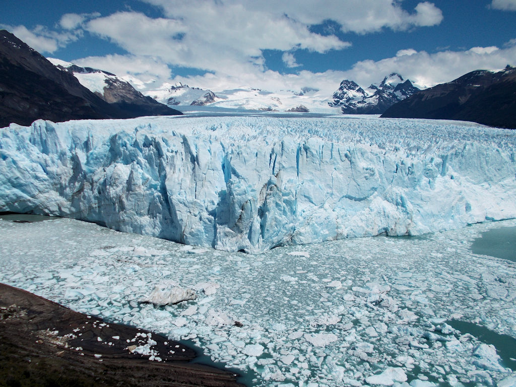 jagged blue and white ice and snow capped mountains Moreno Glacier Argentina