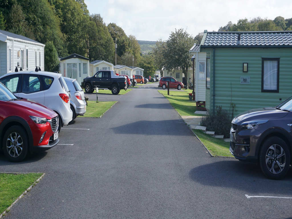 cars next to static caravans at Cardigan Bay Holiday Park